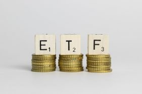 Exchange-Traded Fund (ETF) On A Stack Of Coins
