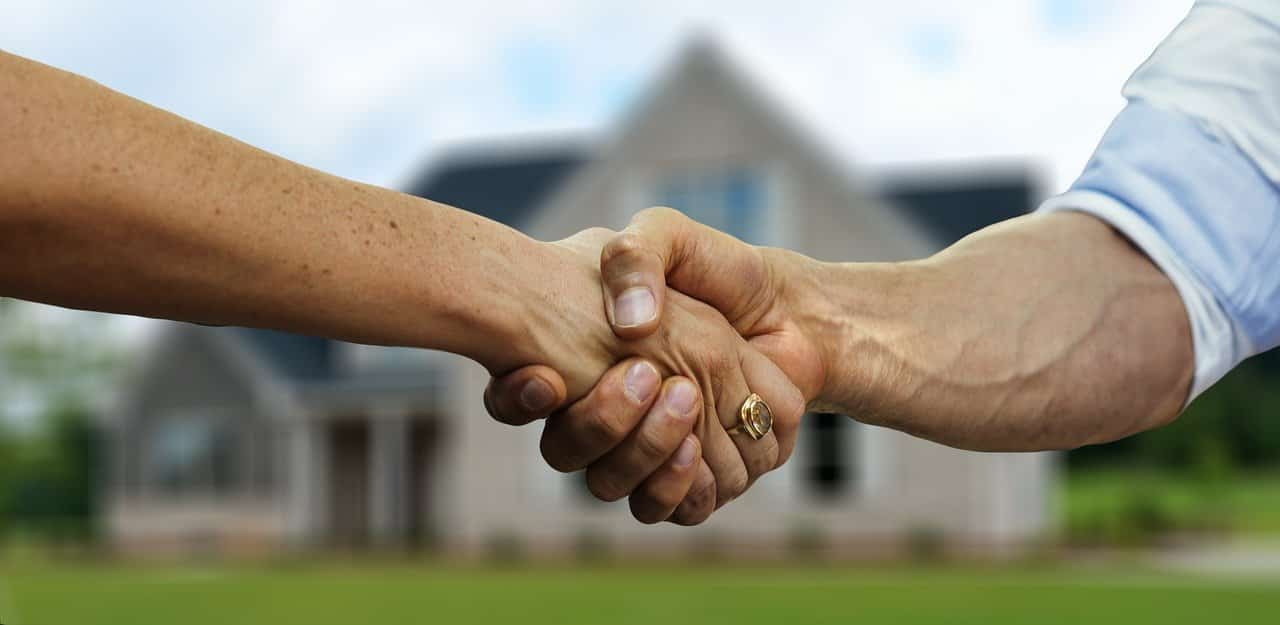 Shaking Hands Over The Purchase Of A House