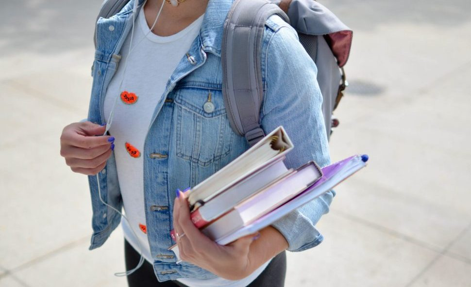 University student carying books