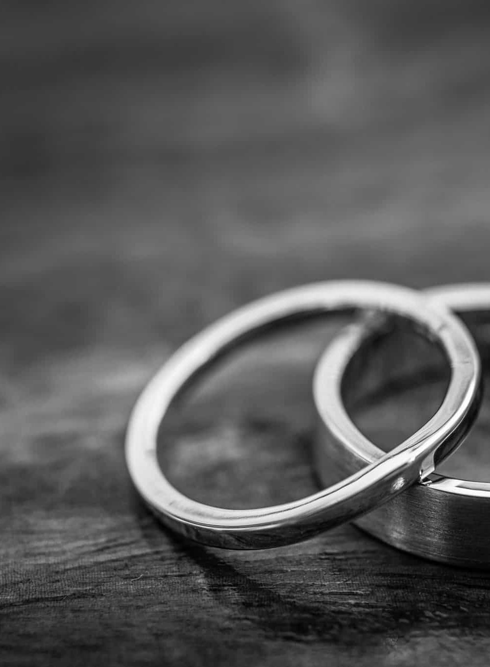 Palladium Wedding Rings On A Wooden Surface