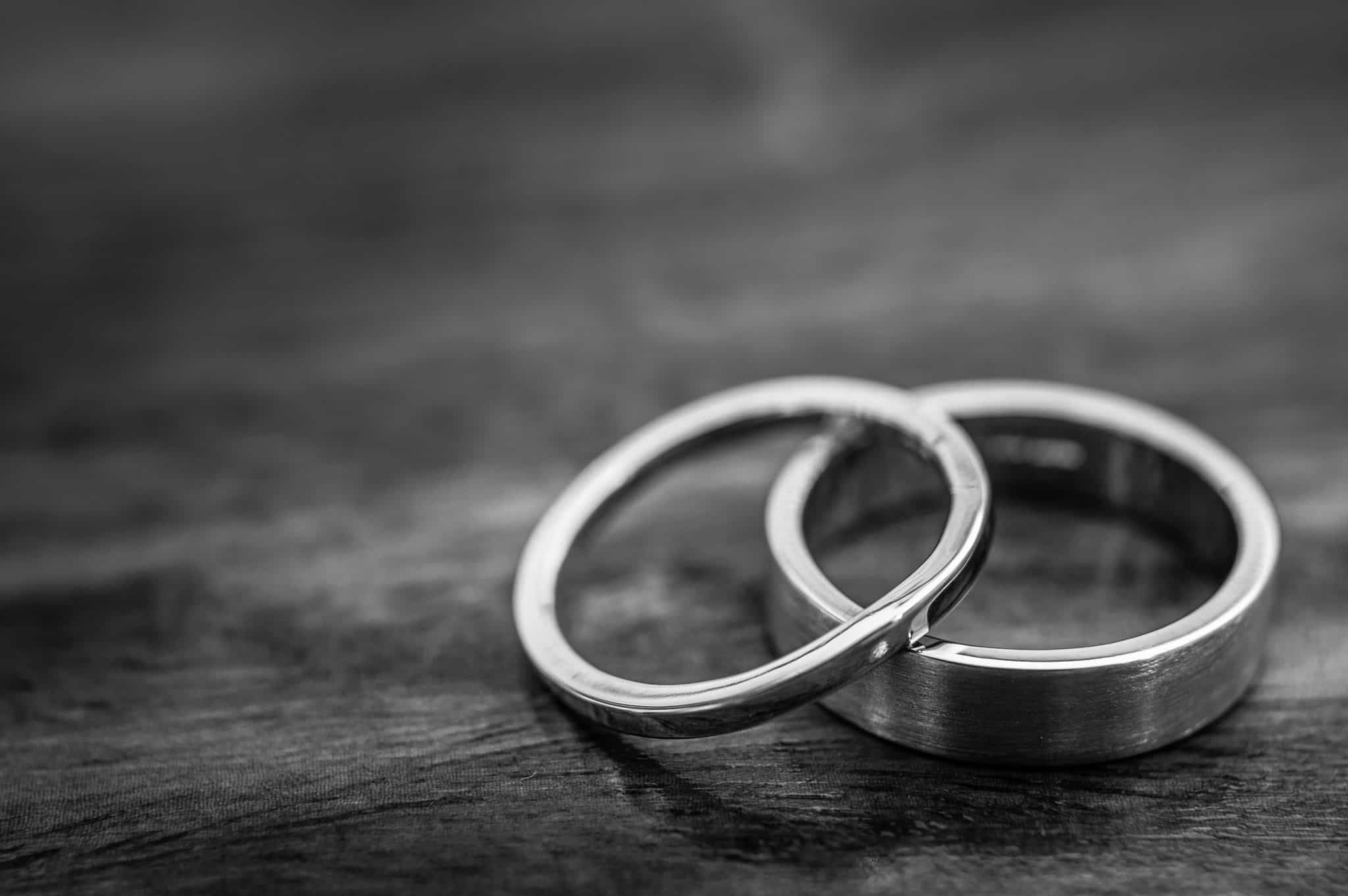 Palladium Wedding Rings On A Wooden Surface